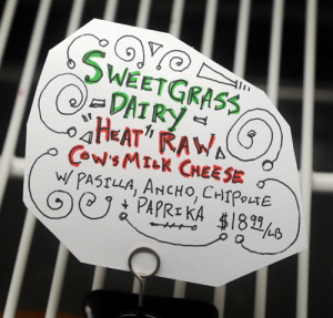 The sales sign at Wine World for Sweet Grass Dairy's Heat raw cow cheese
