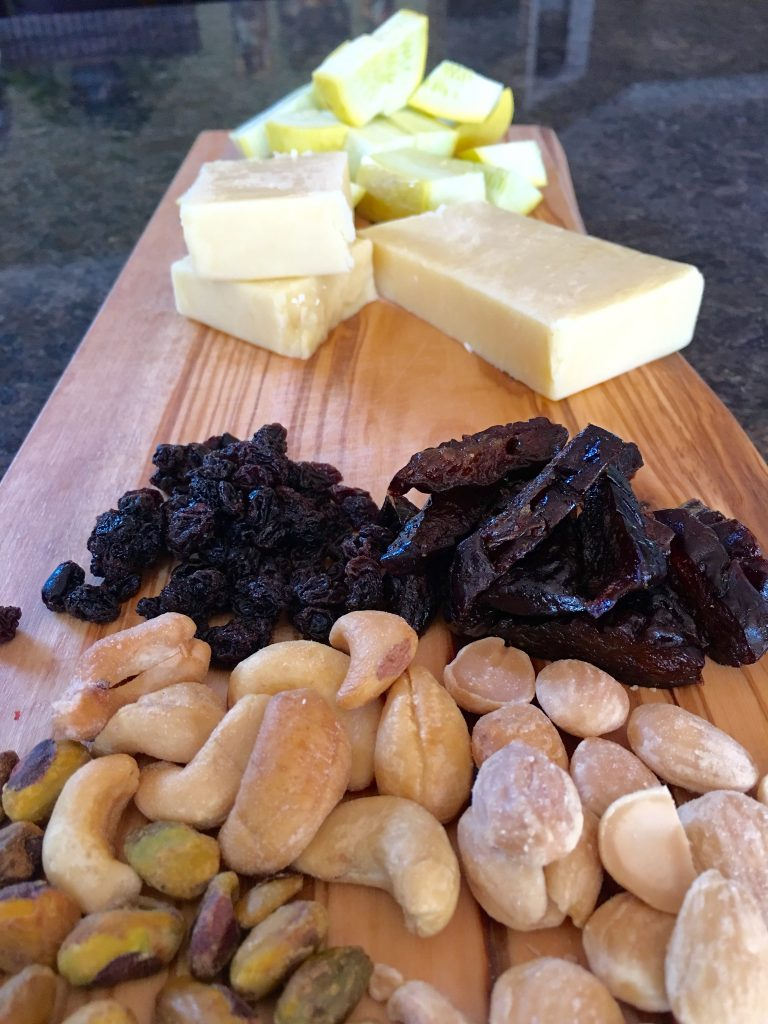 Skellig Sliced on a Cheeseboard with Salted Nuts, Dried Plums and Currants. Divine!